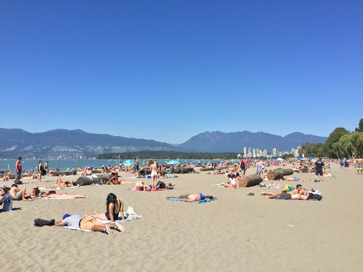 Summer is people-watching season at Kits Beach. | Photo: Carolyn Heller