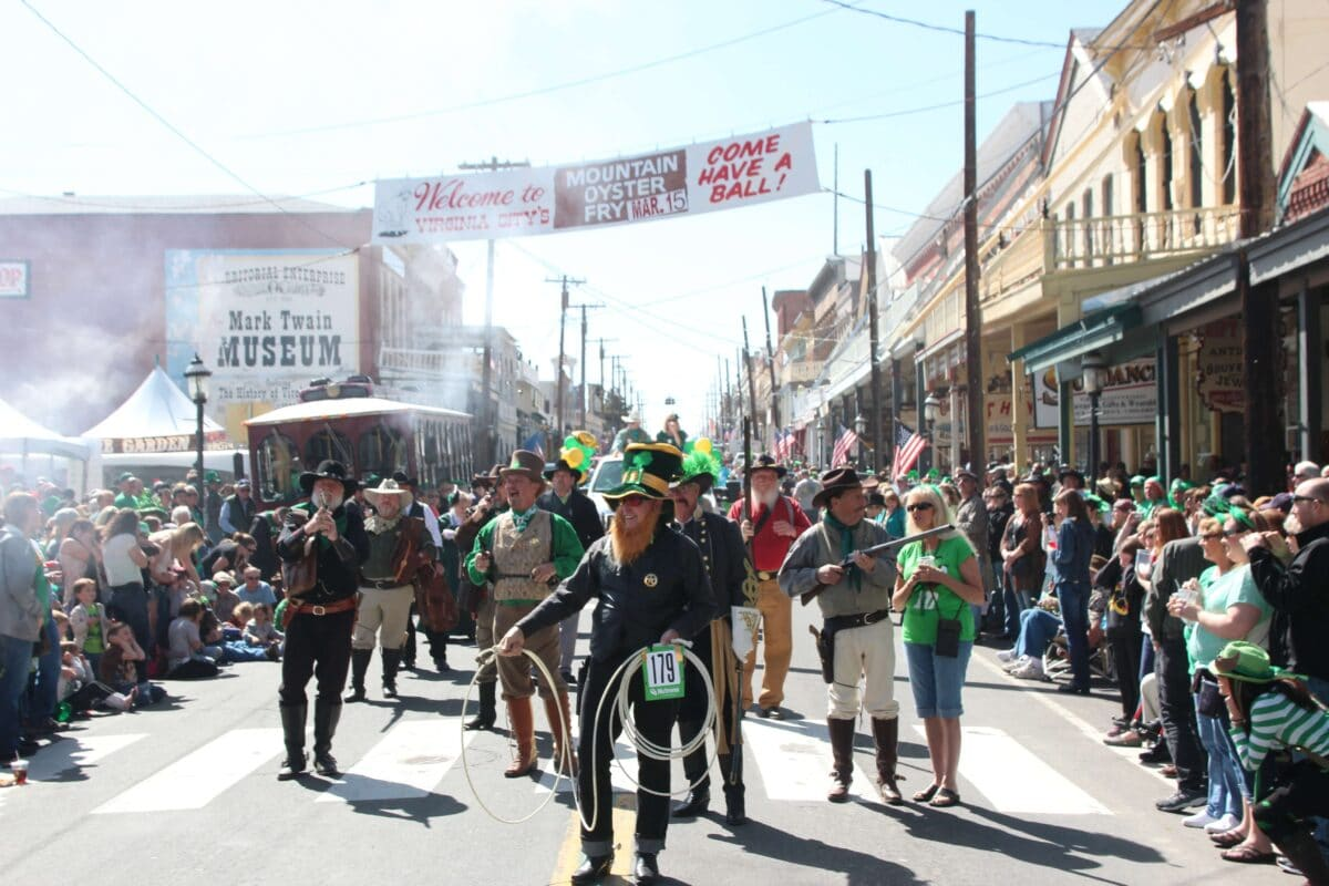 A parade for the Rocky Mountain Oyster Fry with many people wearing St. Patrick's Day Costumes