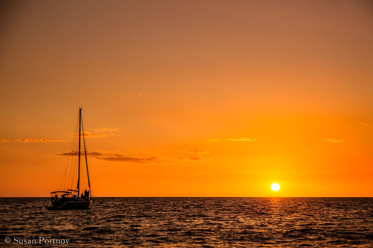 Stunning Silhouette Photos Guaranteed to Inspire Your Travels-A sailboat anchored in the water off Captiva Island in Florida at Sunset.
