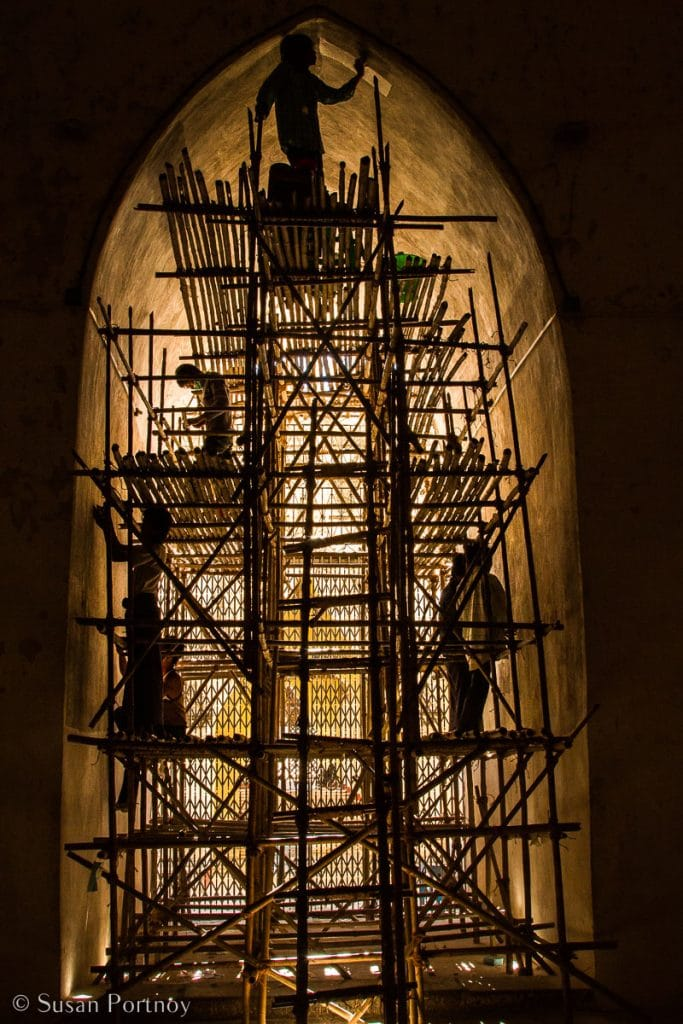 Silhouette Photos Men, working on a rickety, handmade scaffolding, repair a temple in Old Bagan, Myanmar.