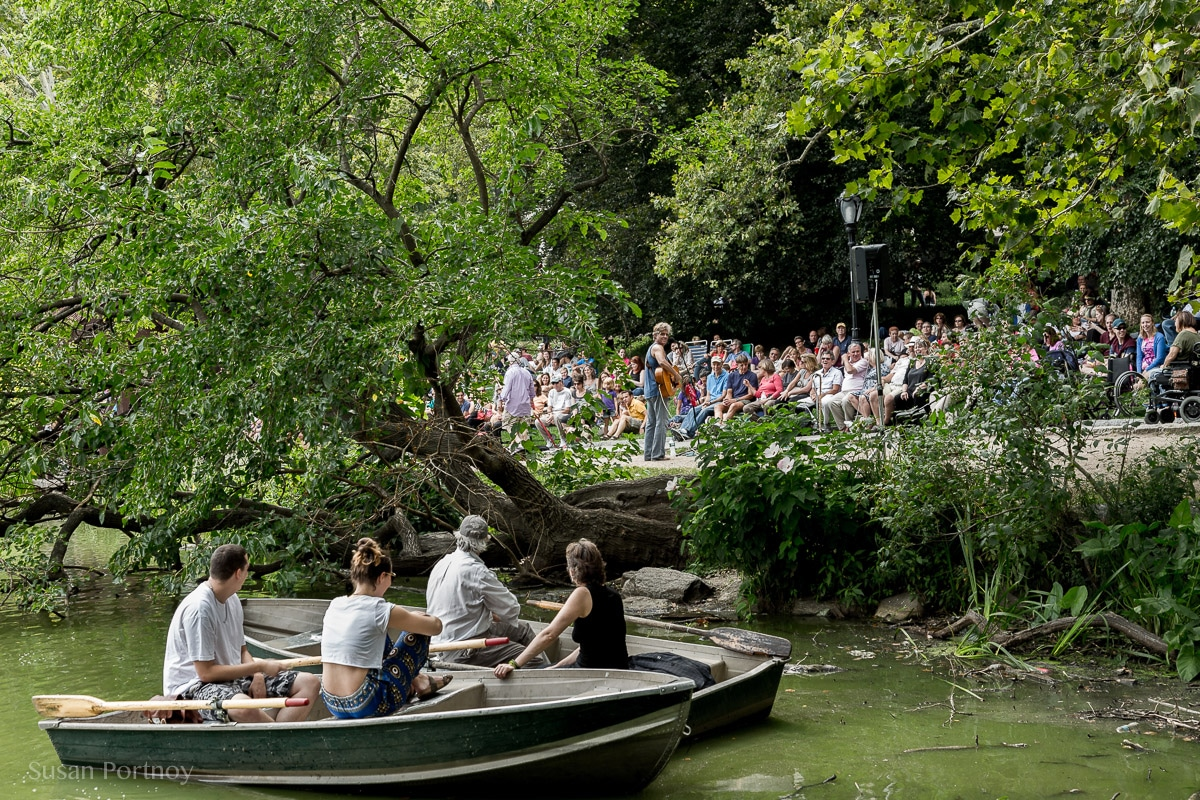 "Boaters on the lake in Central Park stop to listen to David ""Guitar Man"""