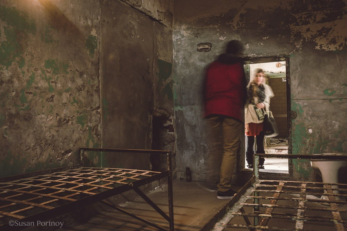 Visitors check out the tunnel entrance dug by Clarence Klinedinst and his cellmate, William Russell at Eastern State Penitentiary