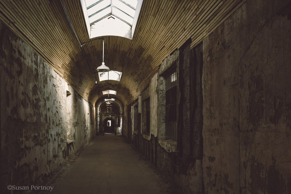 View past the gate of cellblock 2 Eastern State Penitentiary