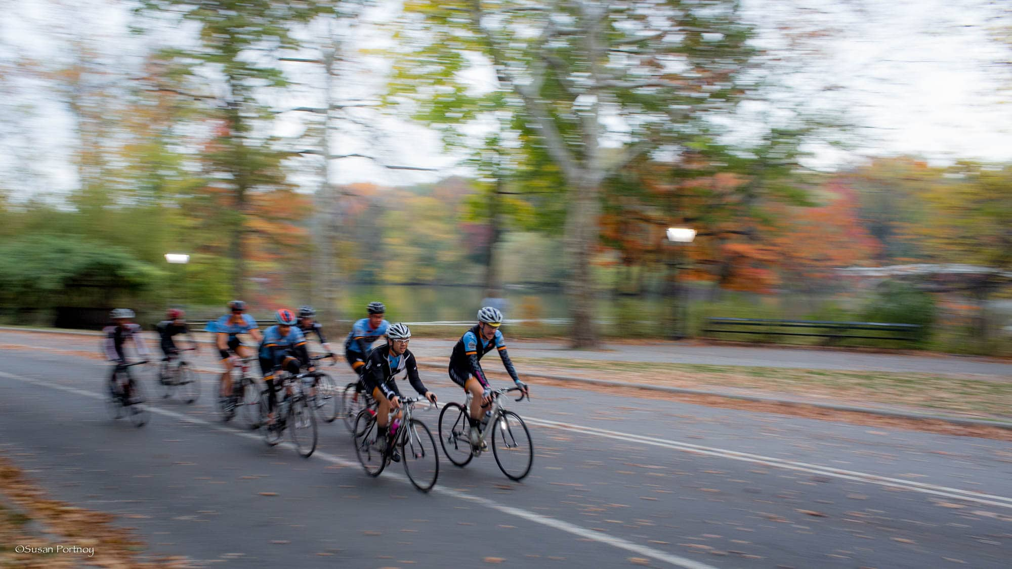 Cyclist packs biking in Central Park at sunrise