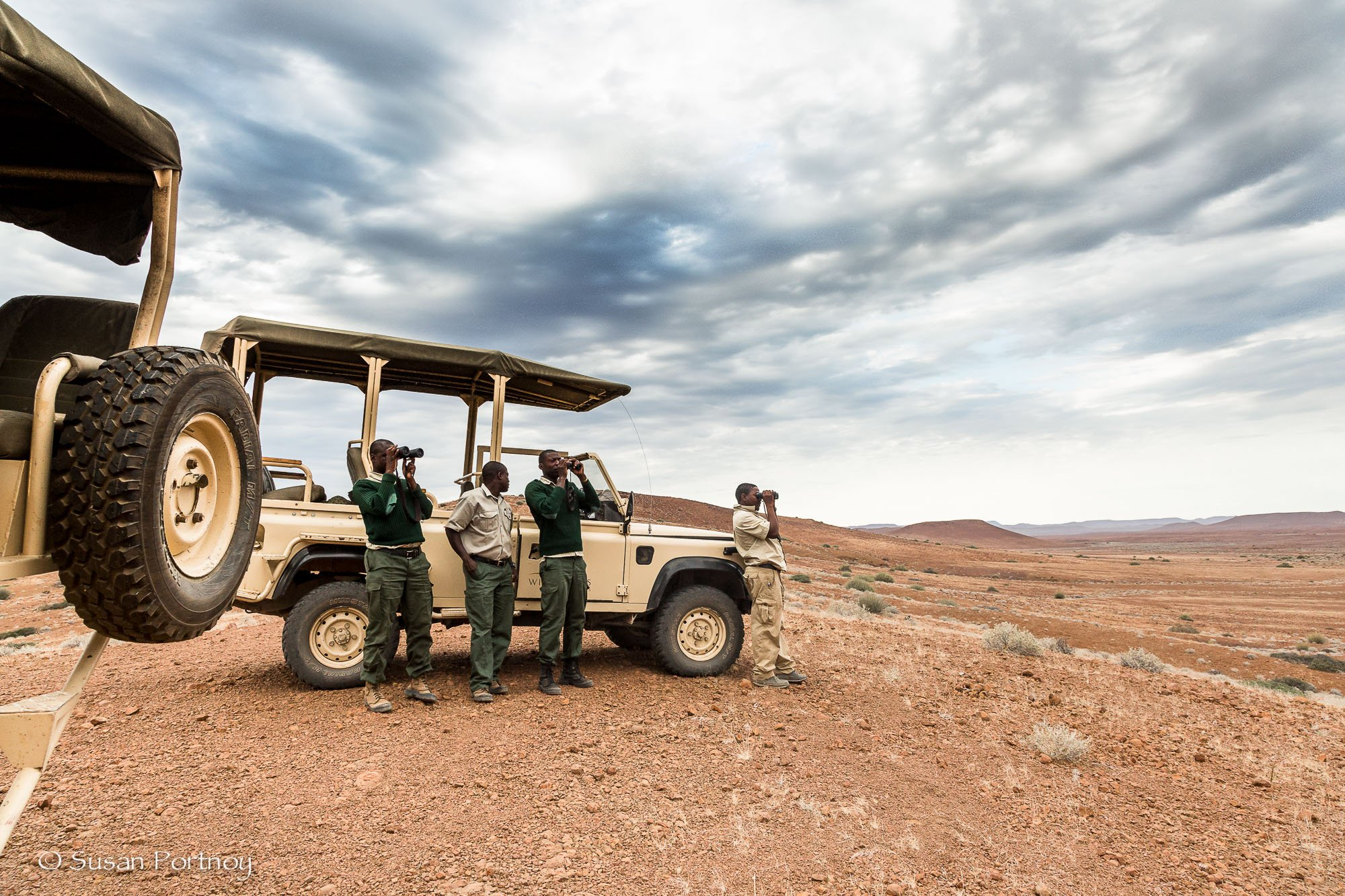 Three Save the Rhino Trust rangers and my guide Bons Roman
