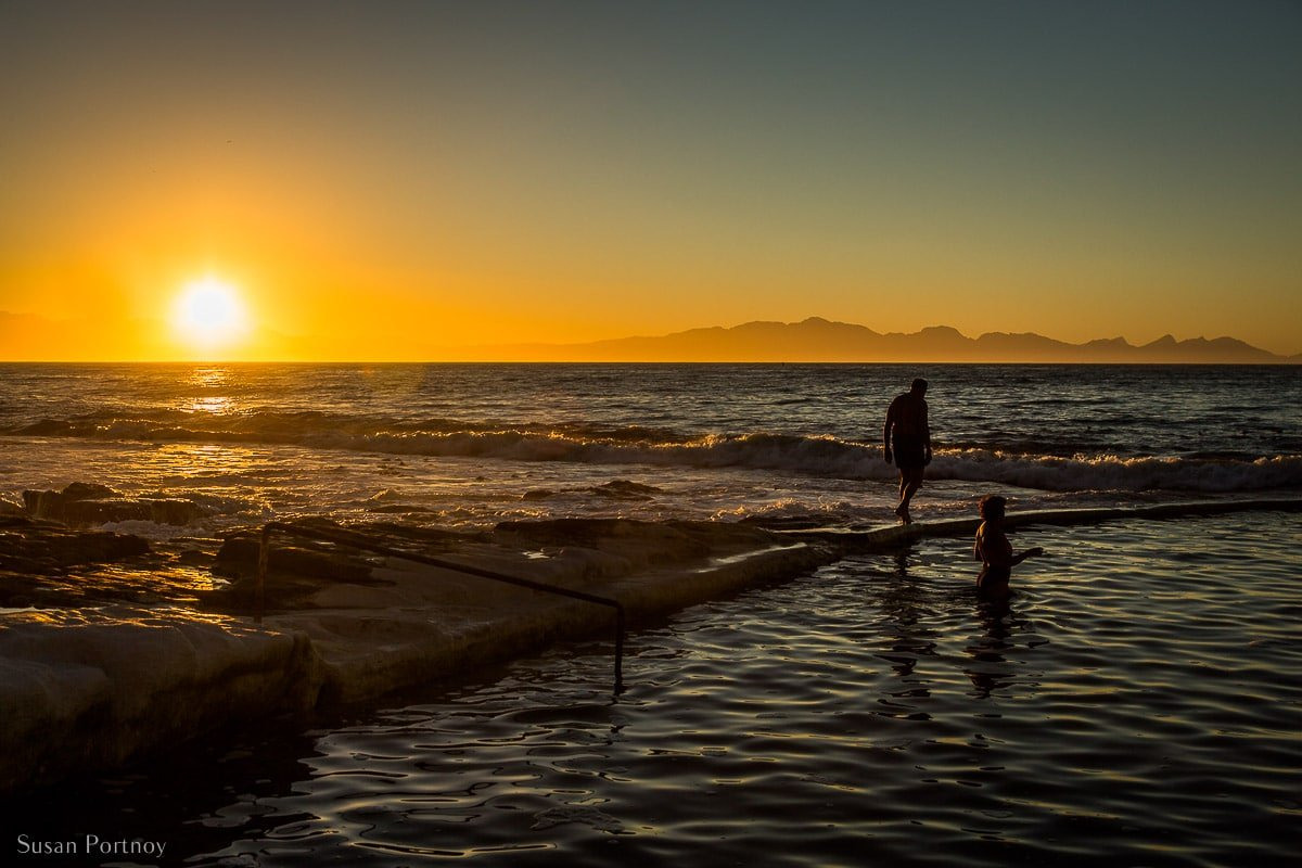 South African locals swimming in a tidal pool near Kalk Bay