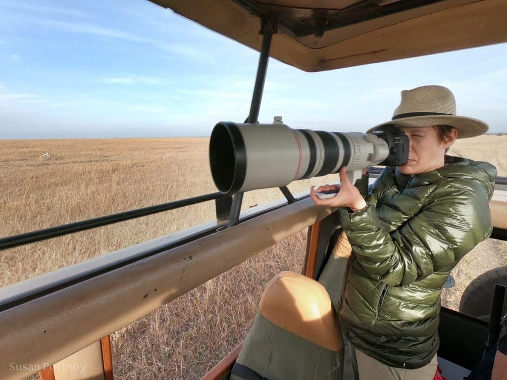 Susan Portnoy, the Insatiable Traveler, photographing in the Masai Mara - safari Packing List