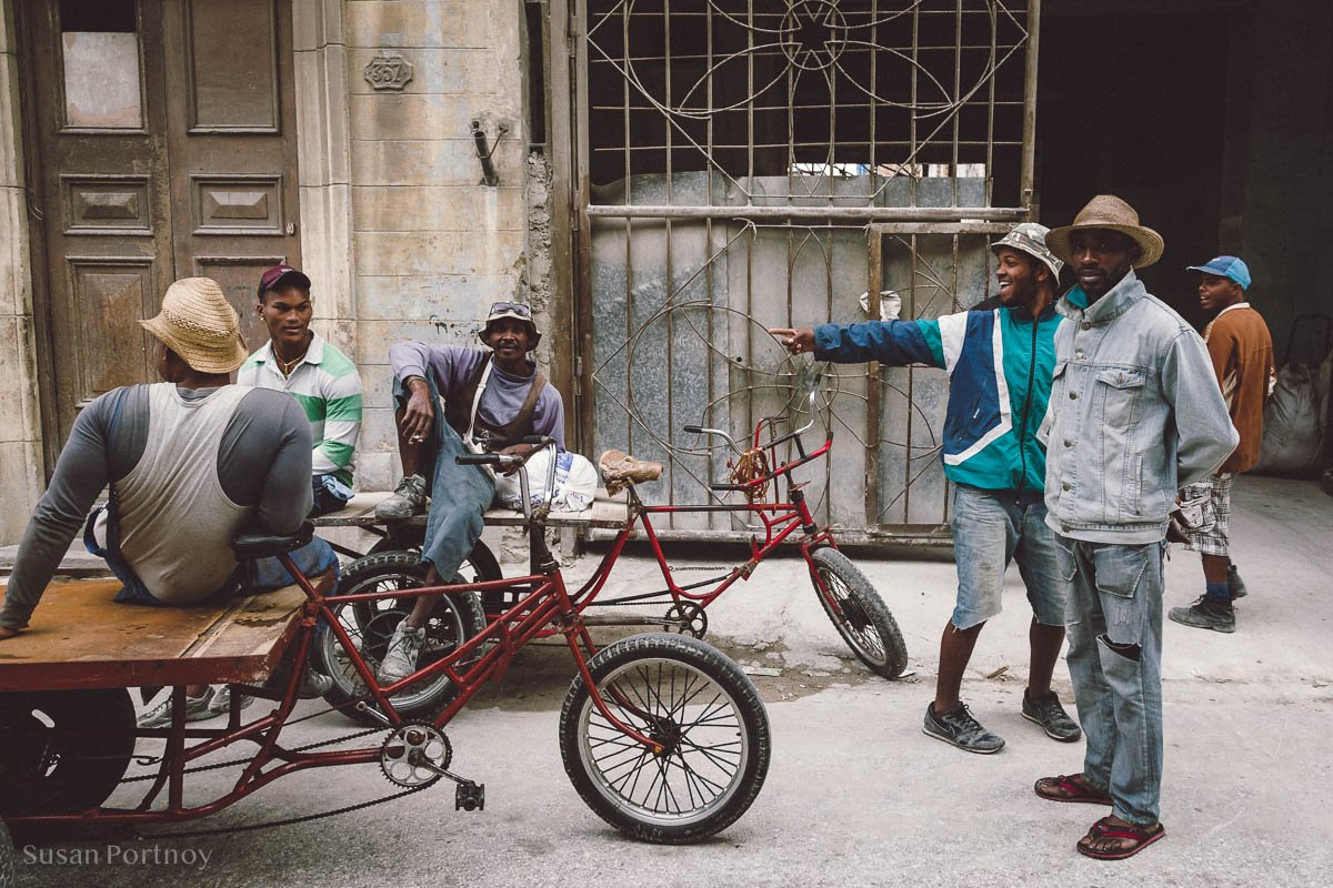 Group of men hanging out in Havana Central