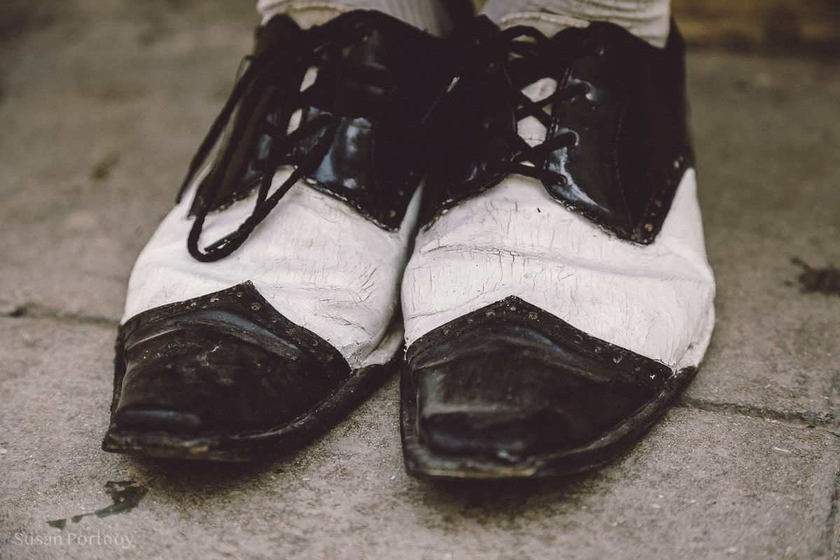 Black and white wing-tipped shoes