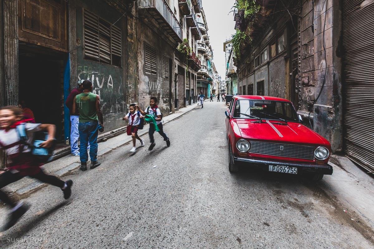 Children running down the street in Havana