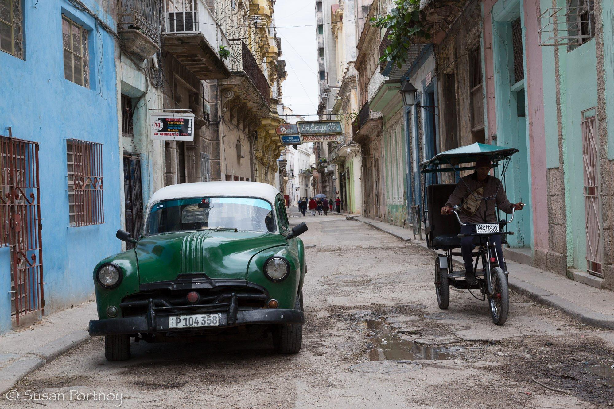 Green classic car in Havana, Cuba
