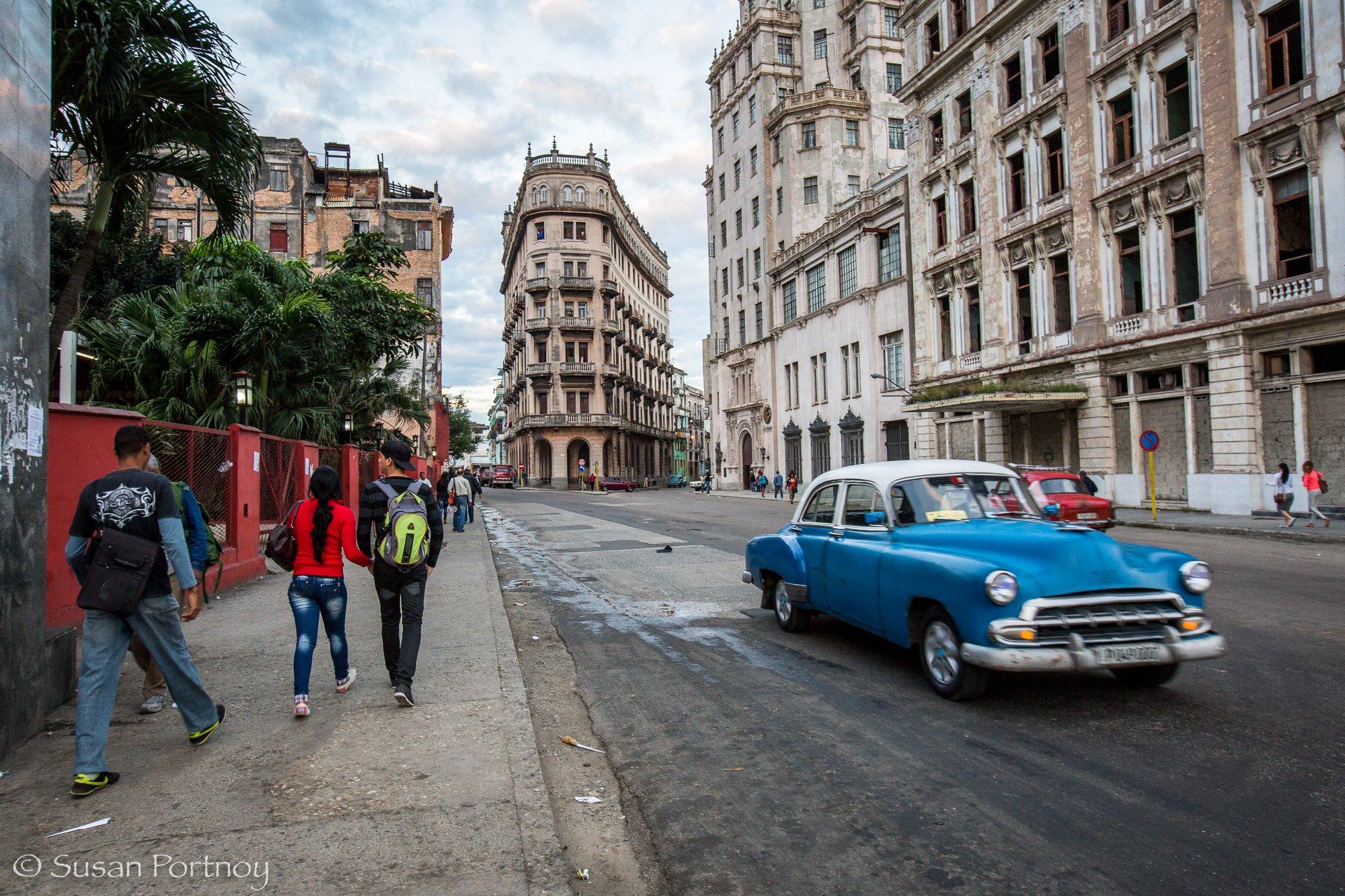 Blue classic car driving in Havana, Cuba