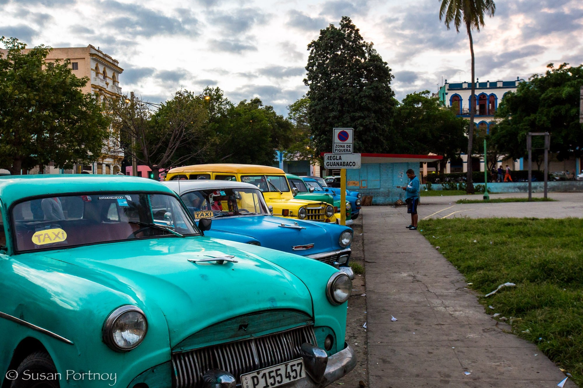 Line up of colorful parked classic cars in Havana, Cuba