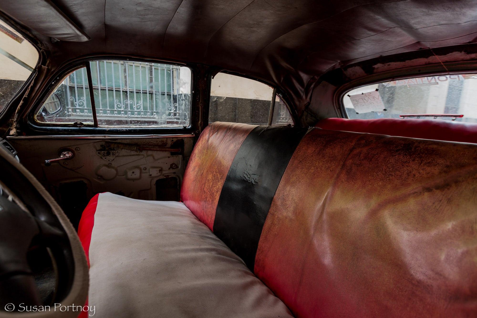 Front seats of red classic car in Havana, Cuba