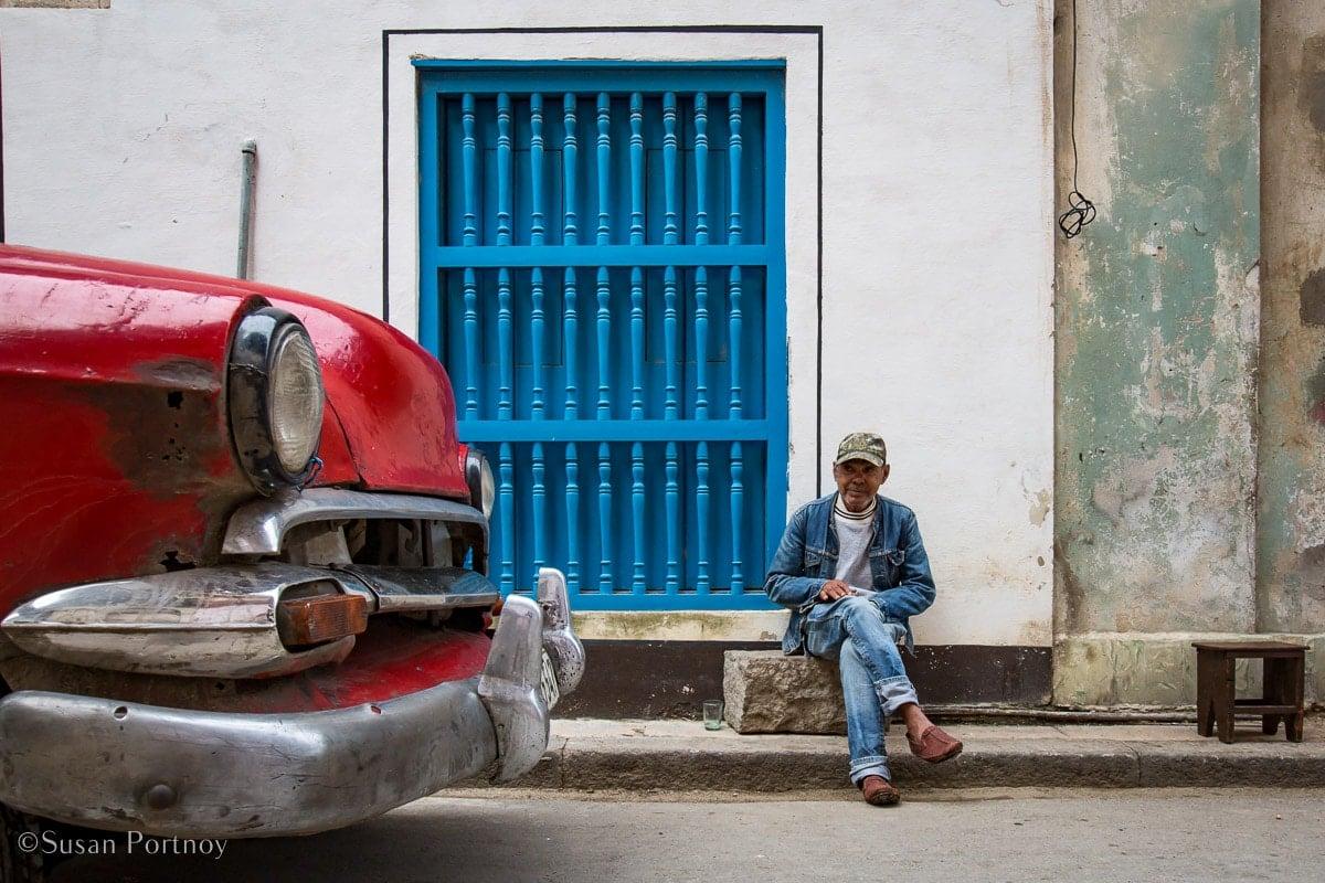man, woman and child on a street in Havana, Cuba
