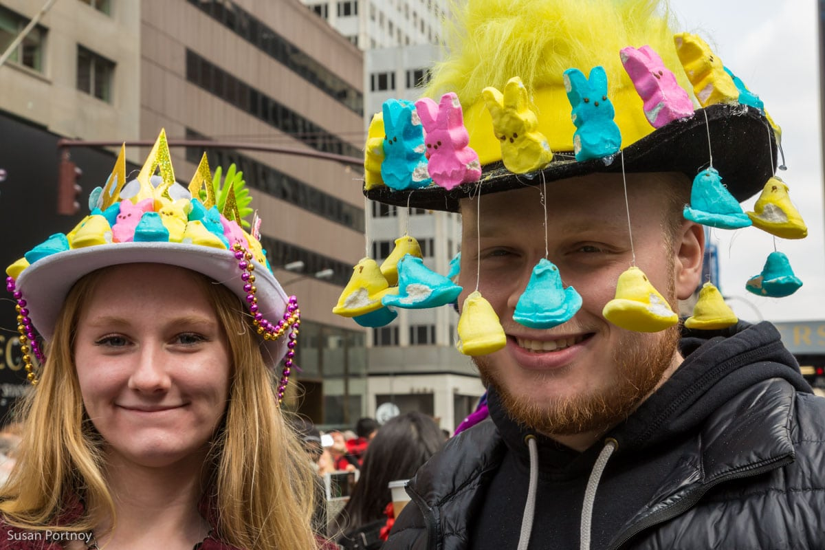 Man and woman wearing marshmellow peep hat at the Easter Parade New York City 2016