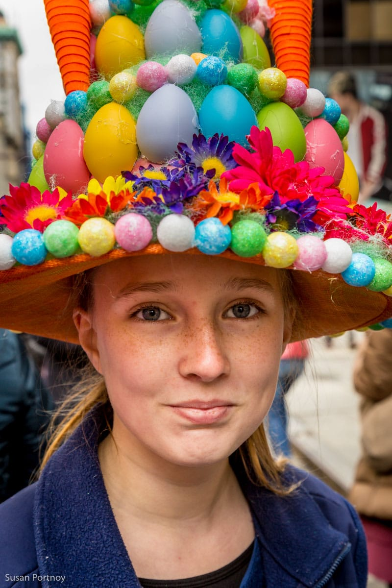 Girl wearing easter egg hat costume in the Easter Parade NYC in 2016