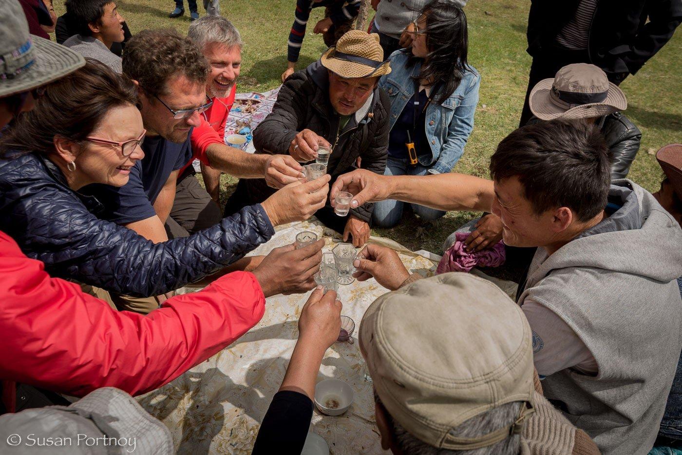 Vodka toasts in Altai Tavan Bogd National Park, Mongolia-031212
