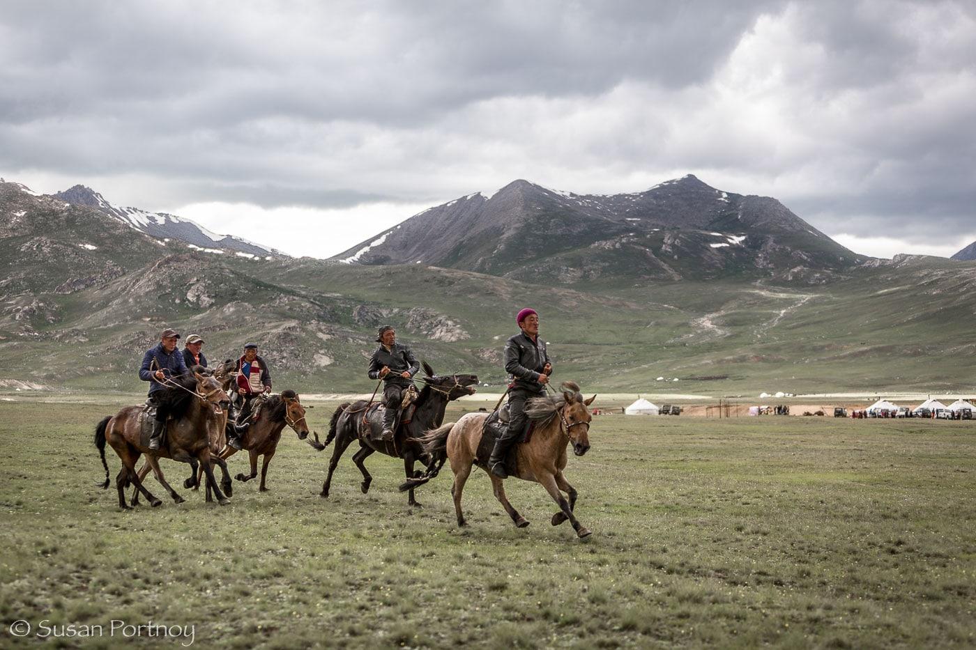 Kazakh riders race in the Altai Tavan Bogd National Park, Mongolia