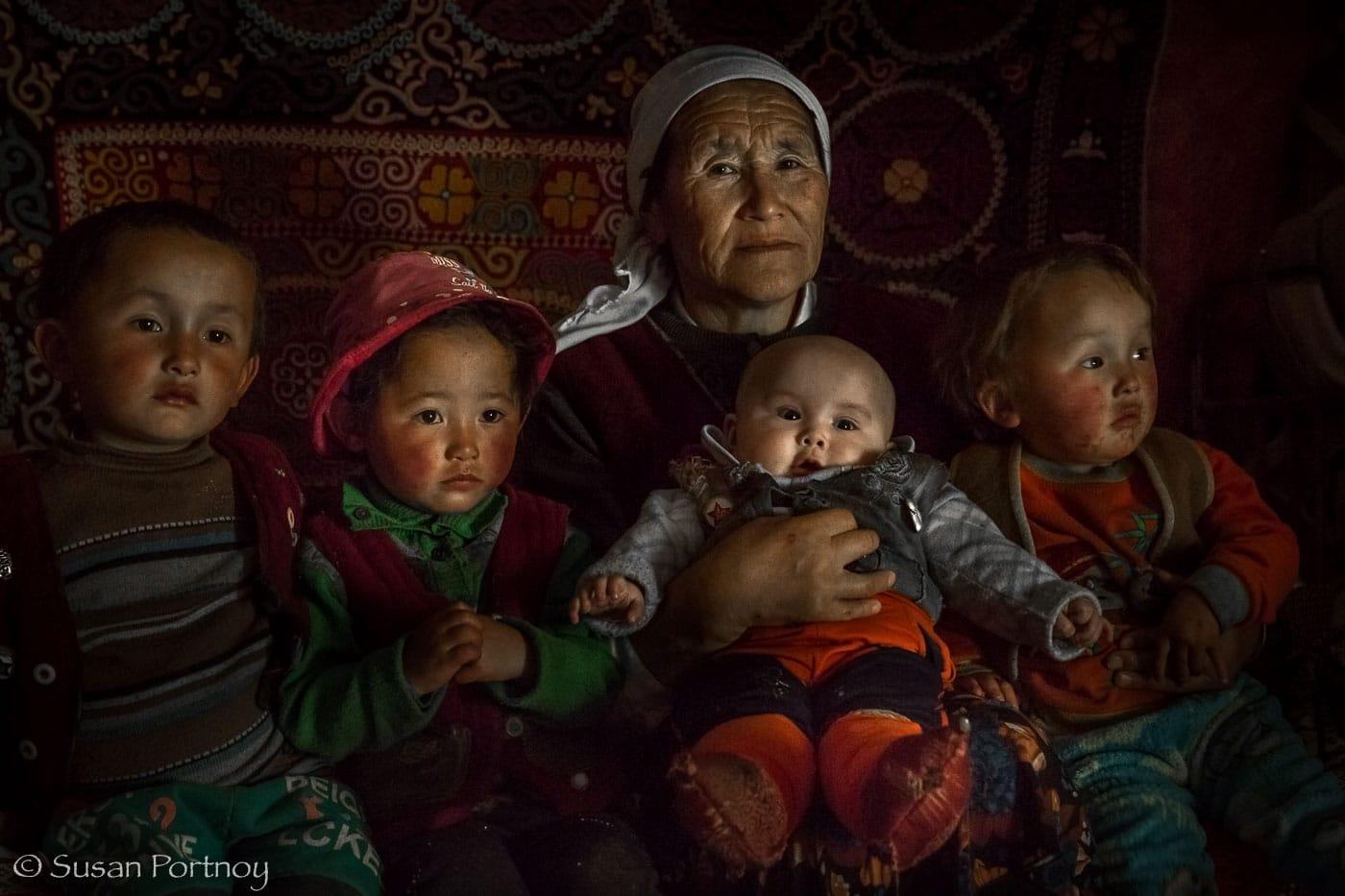 A Kazakh grandmother and her grandchildren in Altai Tavan Bogd National Park, Mongolia-