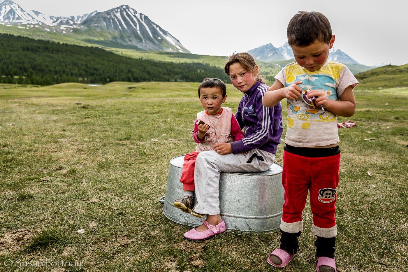 Three Kazakh children in the Altai Tavan Bogd National Park, Mongolia
