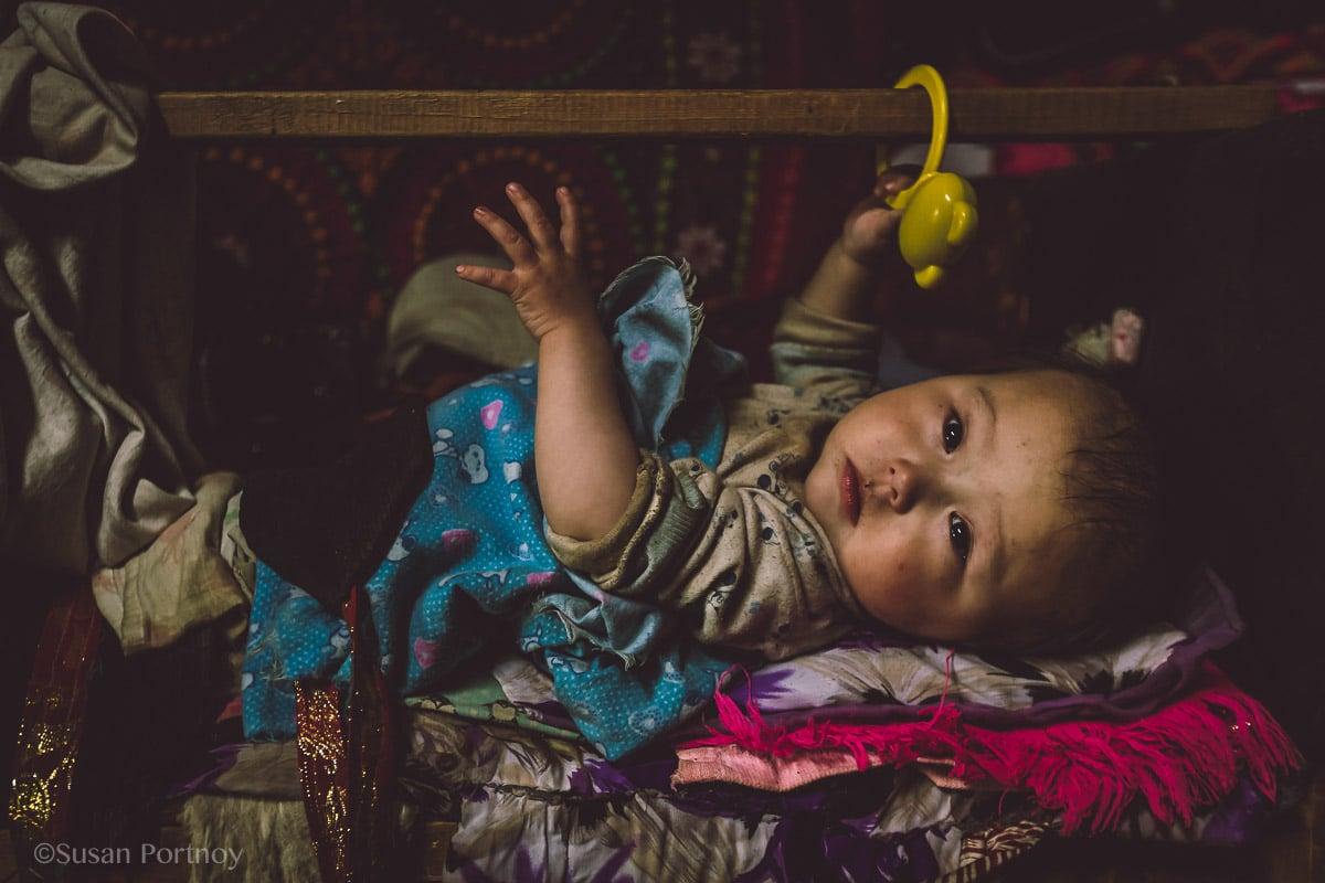 Baby Kazakh Mongolian in a crib