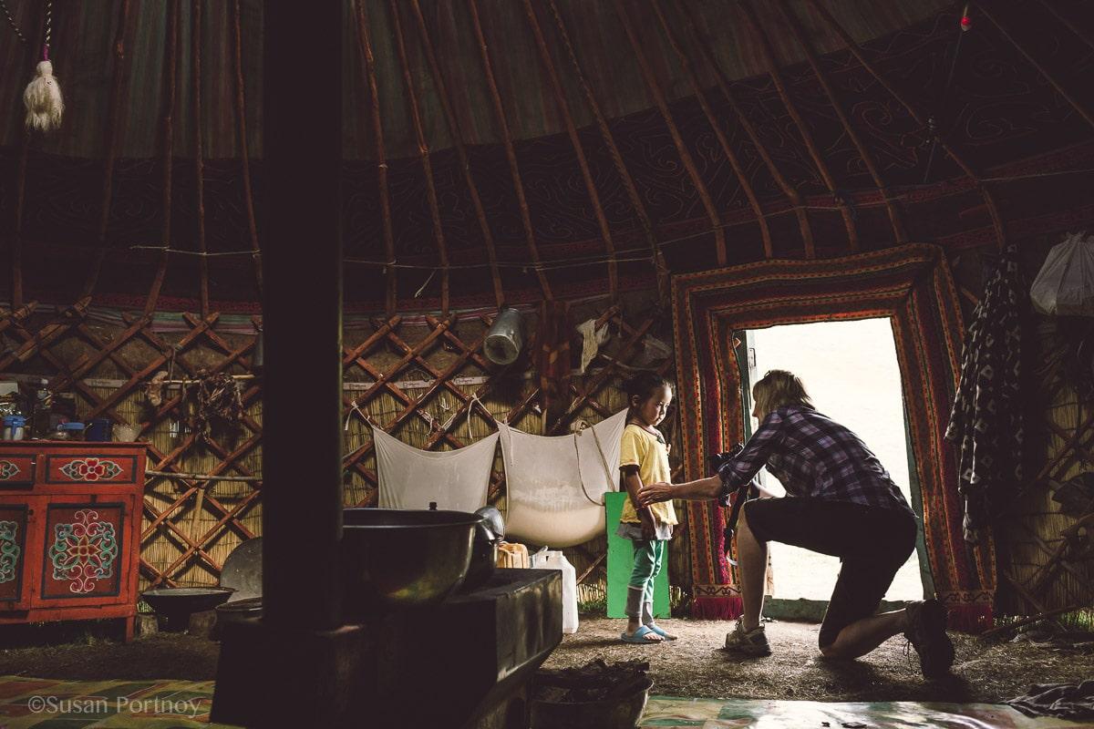 Photographer shooting a little Kazakh girl in Mongolia