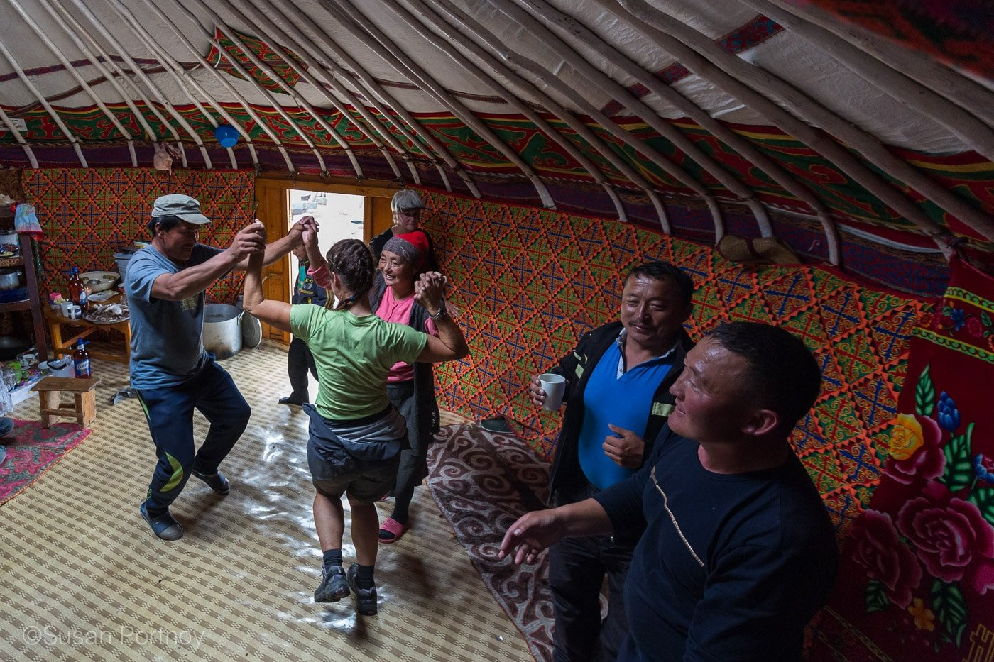 People dancing inside a ger at a Kazakh Mongolian Dance Party - The Insatiable Traveler