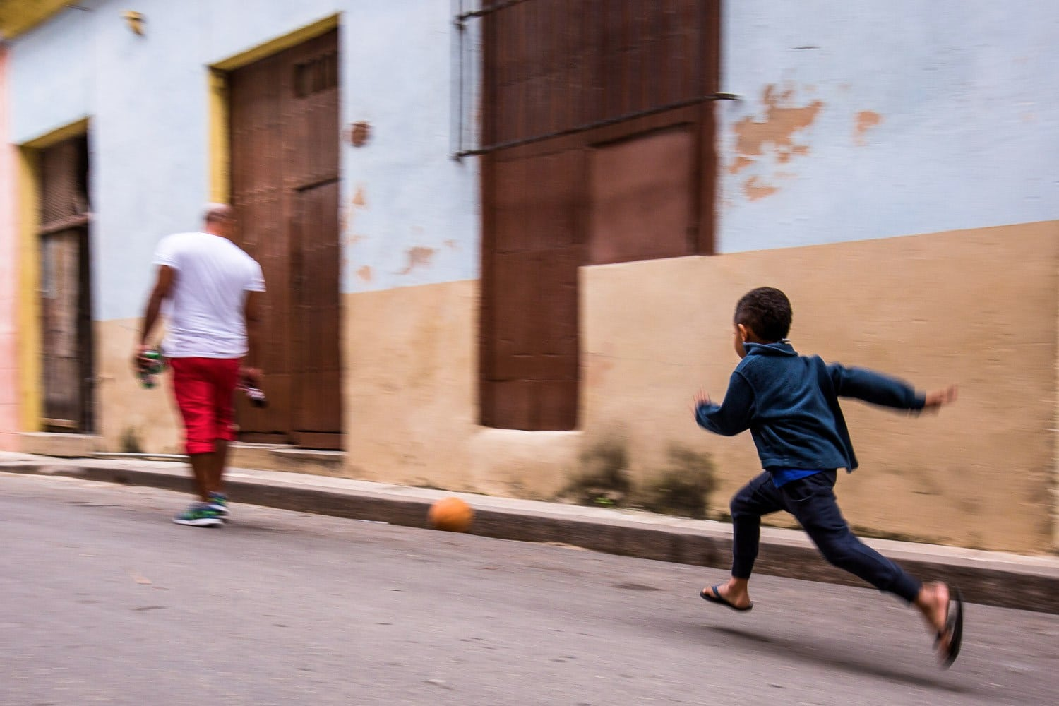 Child kicking a ball in Old Havana, Cuba