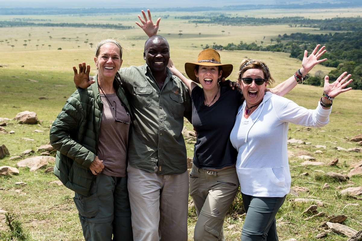 Four people really happy in the Masai Mara including Susan Portnoy, The Insatiable Traveler