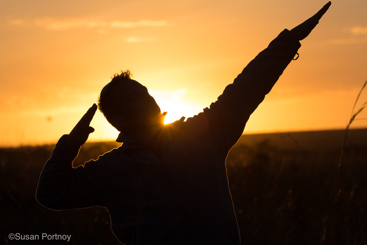 Silhouette of a man backlit by the sun in silhouette