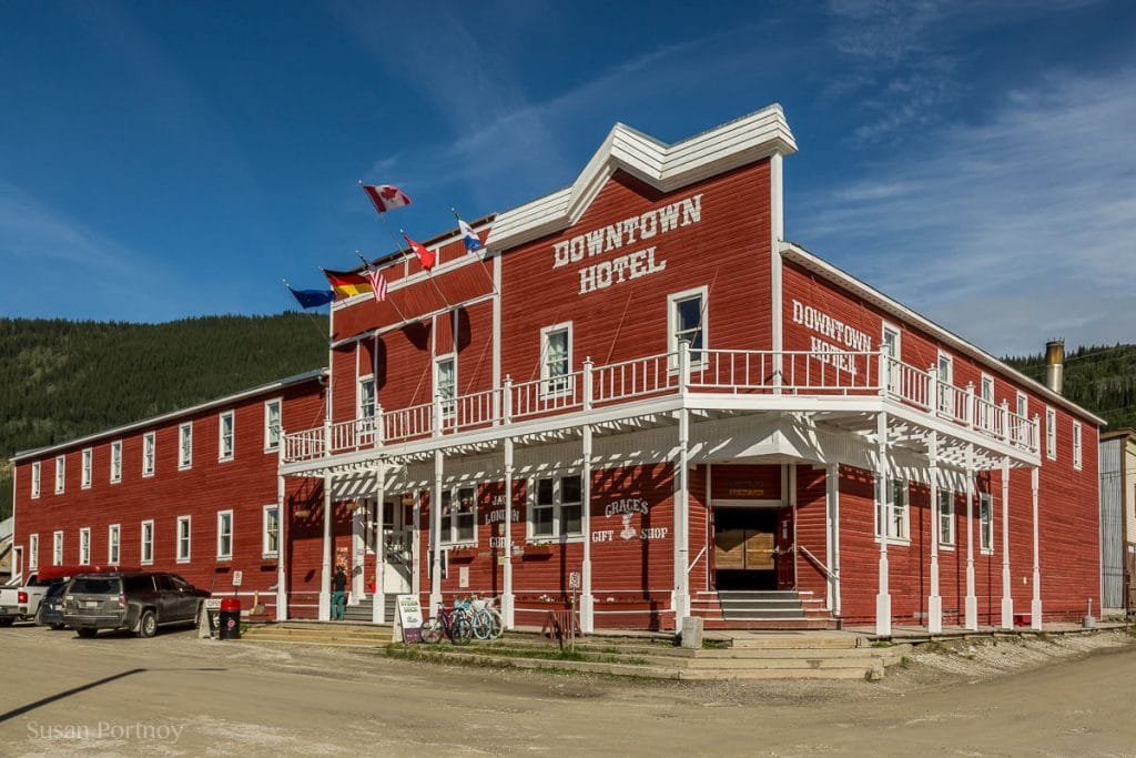 A Sunny Day view of The Downtown Hotel in Dawson City, Yukon