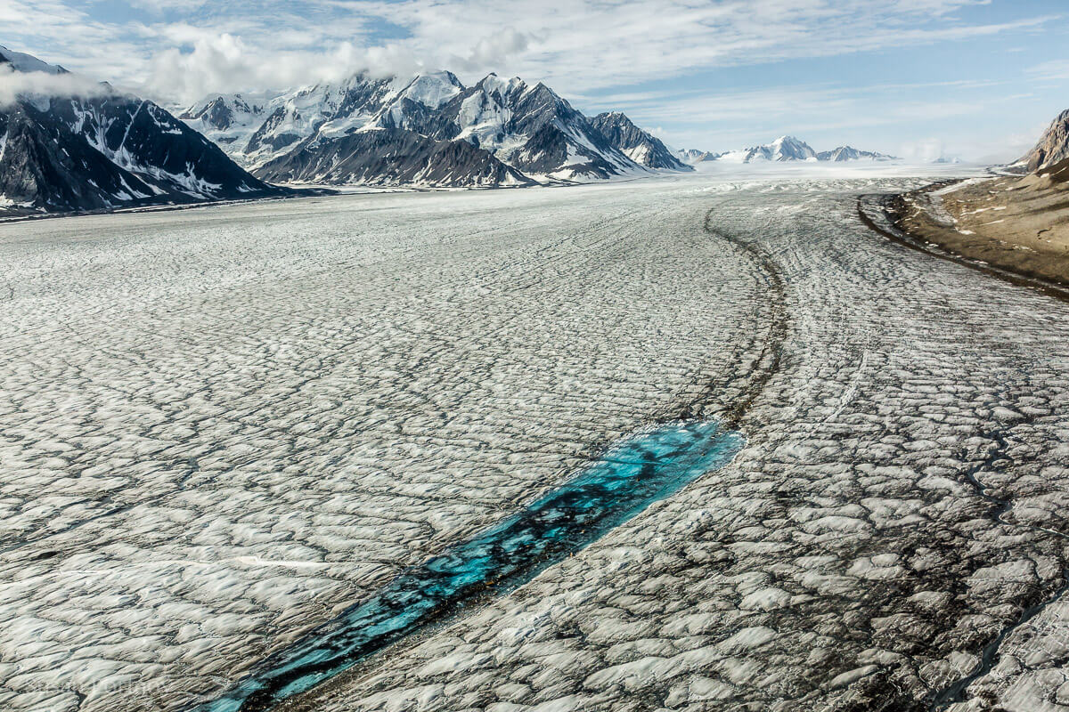 Turquoise meltwater stands out against the surface of the Kaskawulsh glacier--Kaskawulsh glacier in Yukon's Kulane National Park-1277
