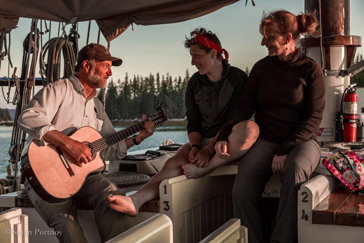 Jon Finger, Ella Finger, Annie Mahle sing above the J & E Riggin-- Windjammer cruise in Maine-636620180704