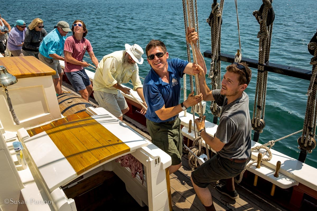 Crew raising the sail on the Riggin -Windjammer cruise in Maine-669220180705