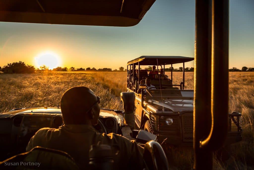 Passing another vehicle on the way to our sundowner spot - Duba Explorers Camp Okavango Delta, Botswana