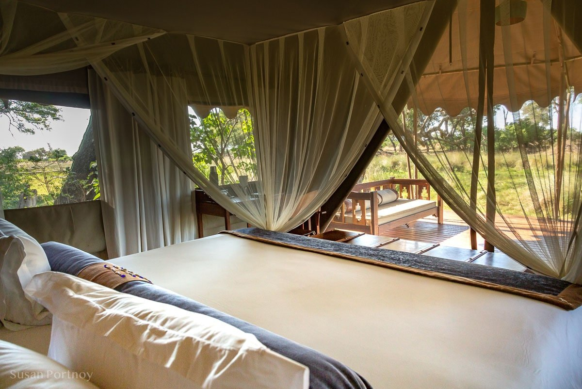 The bed and a view of Okavango Delta from my tent at Duba Explorers Camp