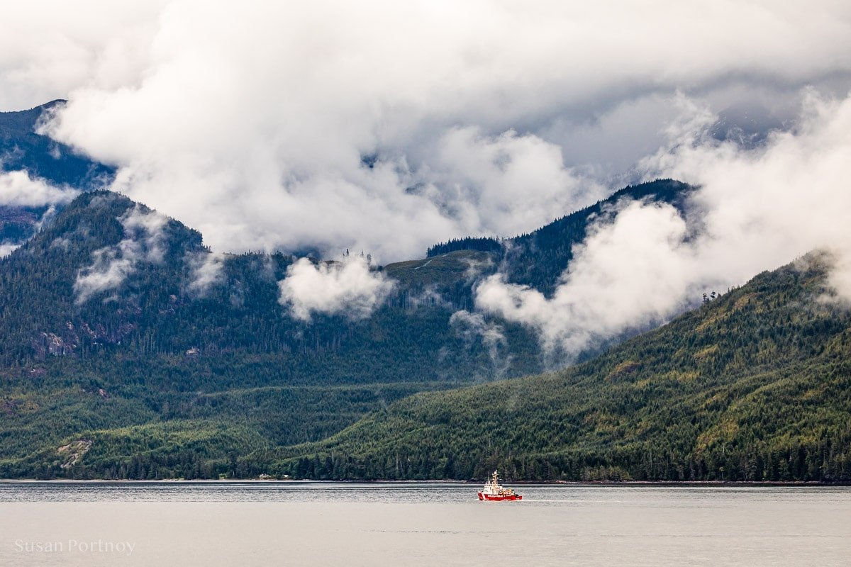 A view of a small boat and mountains  from my veranda in Glacier Bay - Holland Amercia Alaska Cruise