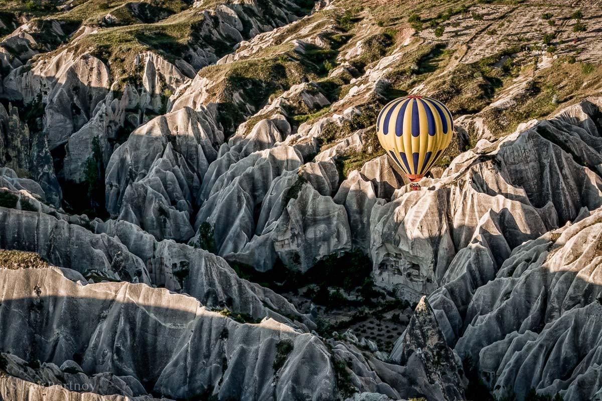 Balloon flying over the sandstone hills of Cappadocia, Turkey