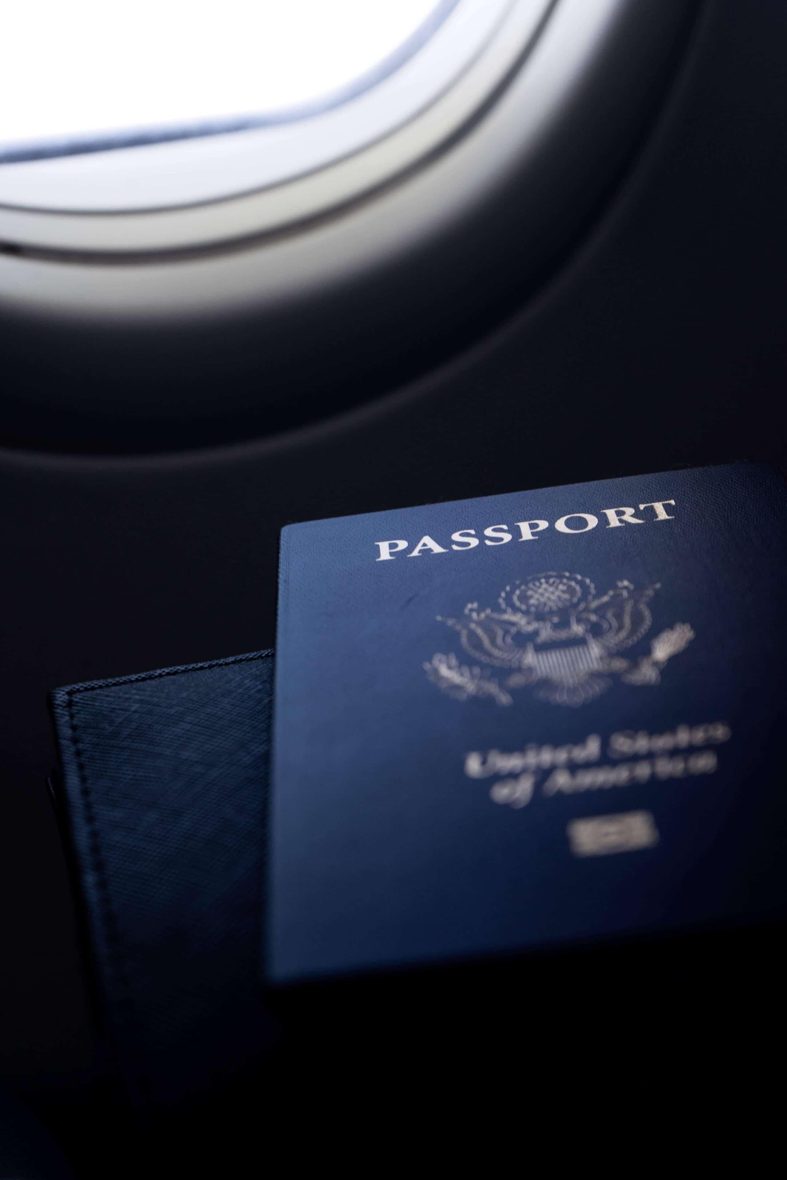 passport next to plane window - upsplash