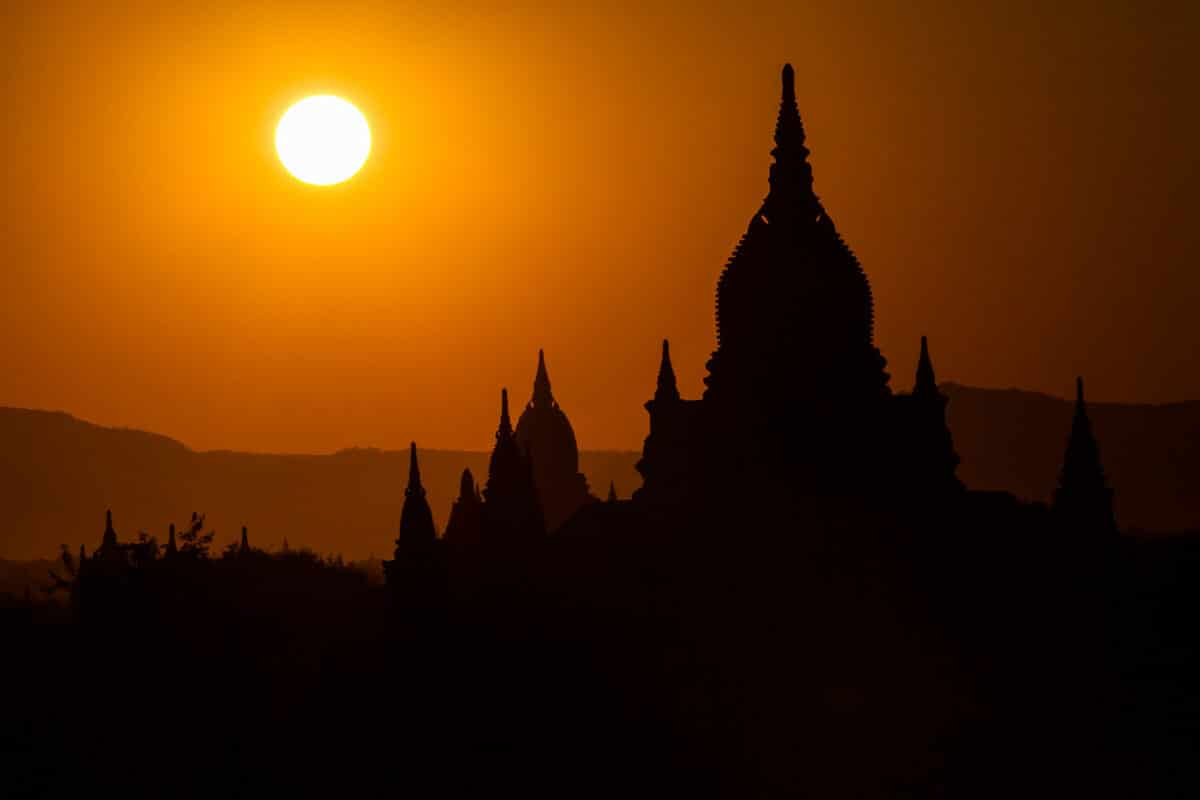 Buddhist Temple in silhouette at sunset.Old Bagan, Myanmar,