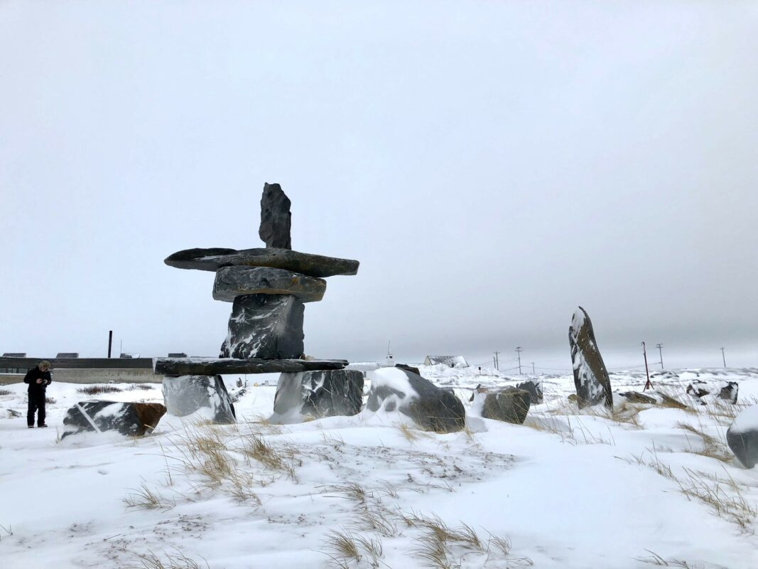 An Inukshuk on the edge of Hudson, Bay, one of the best places to see polar bears.