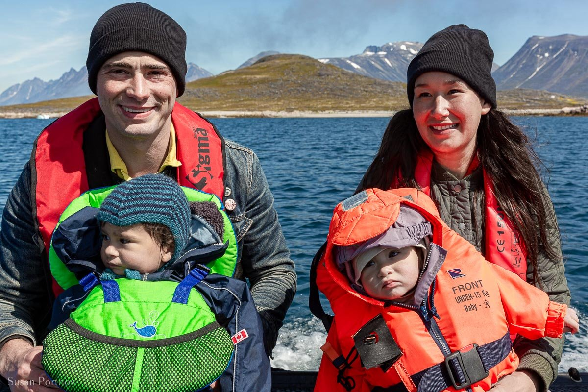 Nive Nielsen, her husband and their two children on a zodiac during our  Greenland cruise.