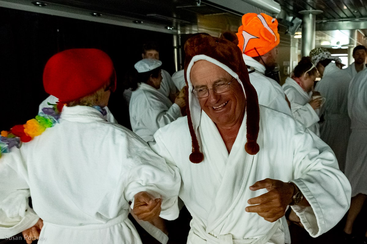 Couples dancing on the Ocean Endeavor in robes before the Polar Plunge