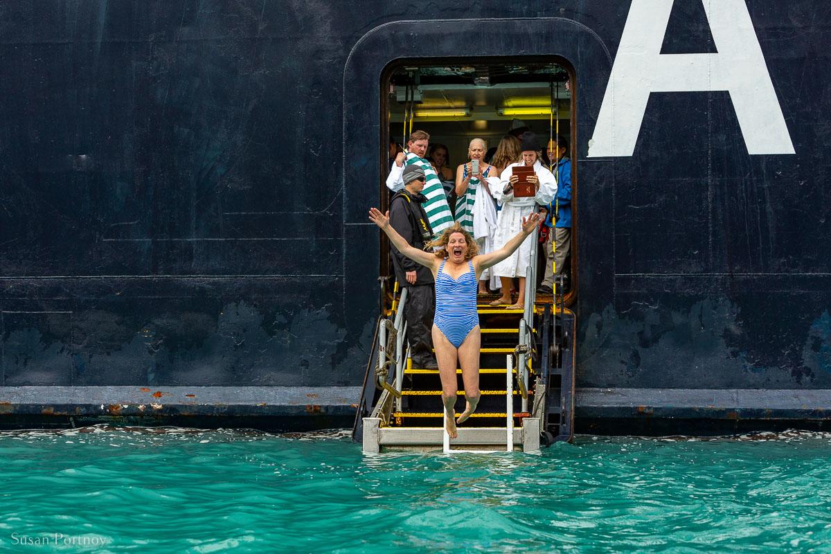 A passenger on the Ocean Endeavor taking the Polar Plunge