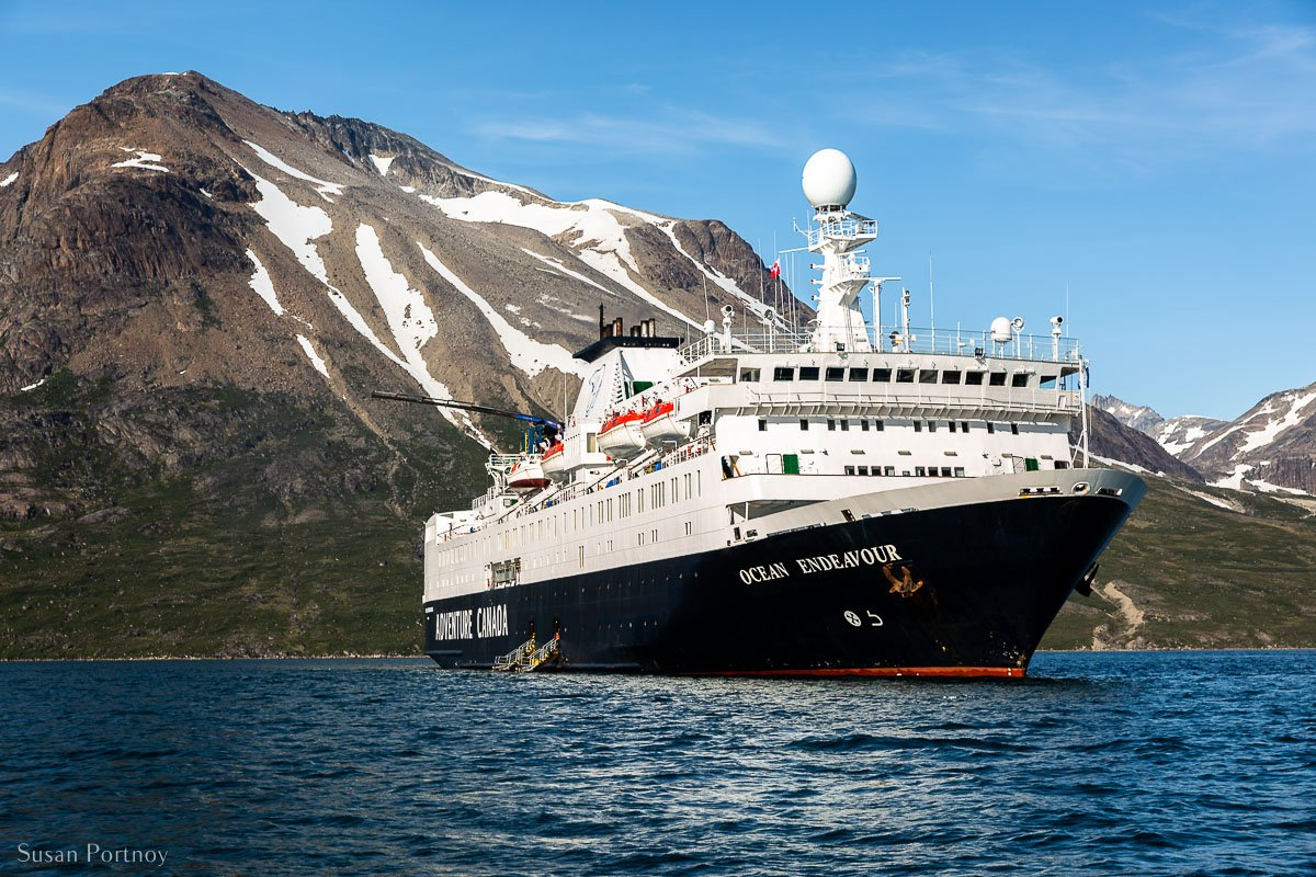 The ship Ocean Endeavor in a fjord in Greenland