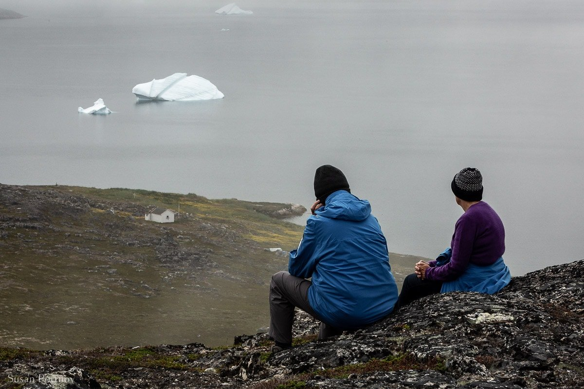 A contemplative moment with two Adventure Canada guests on a high hill on Uunartoq