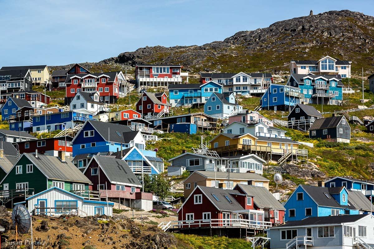 The colorful mountain homes scale a Qaqortoq mountain in Greenland