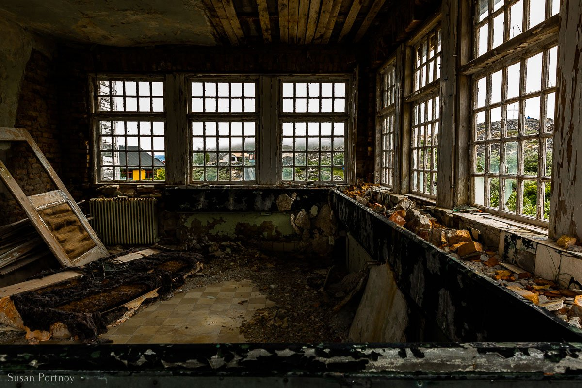 """A view inside the abandoned manager's house called the """"Palace"""" at the Ivittuut mine"""