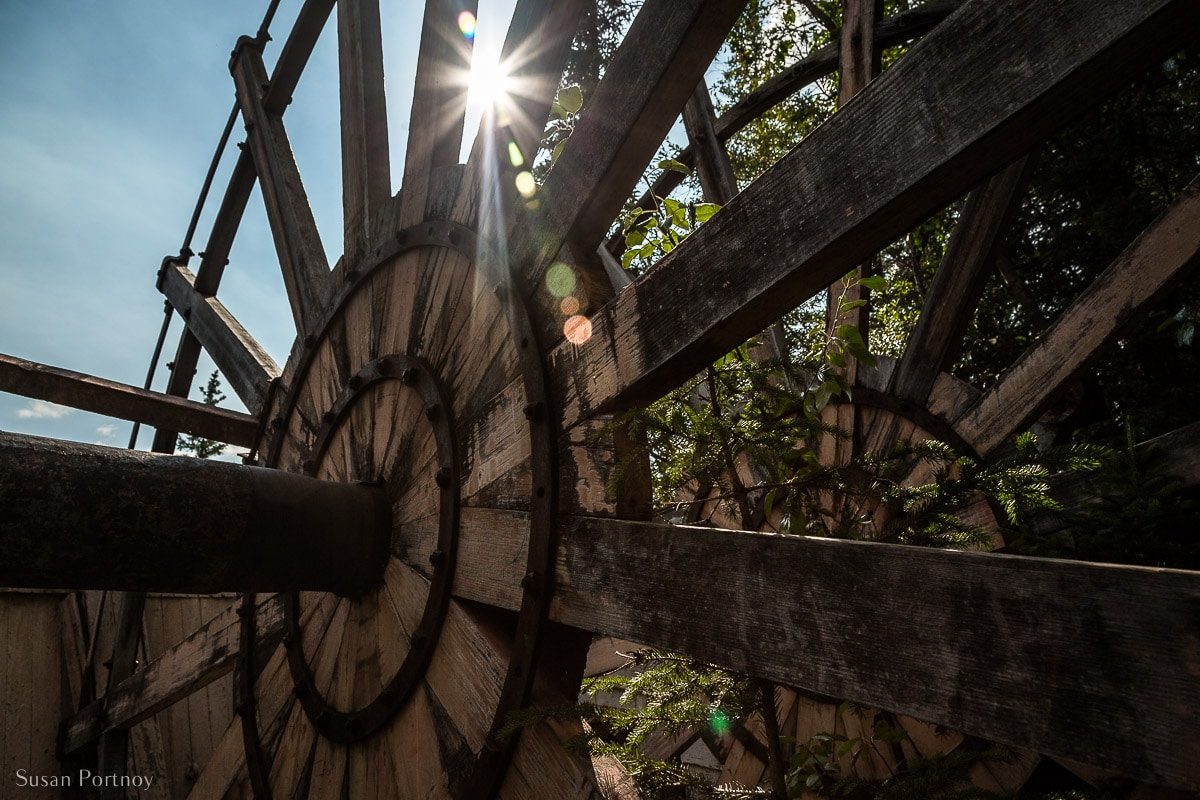 An old wooden wheel from a historic Sternwheeler in the Sternwheeler Graveyard in Dawson City